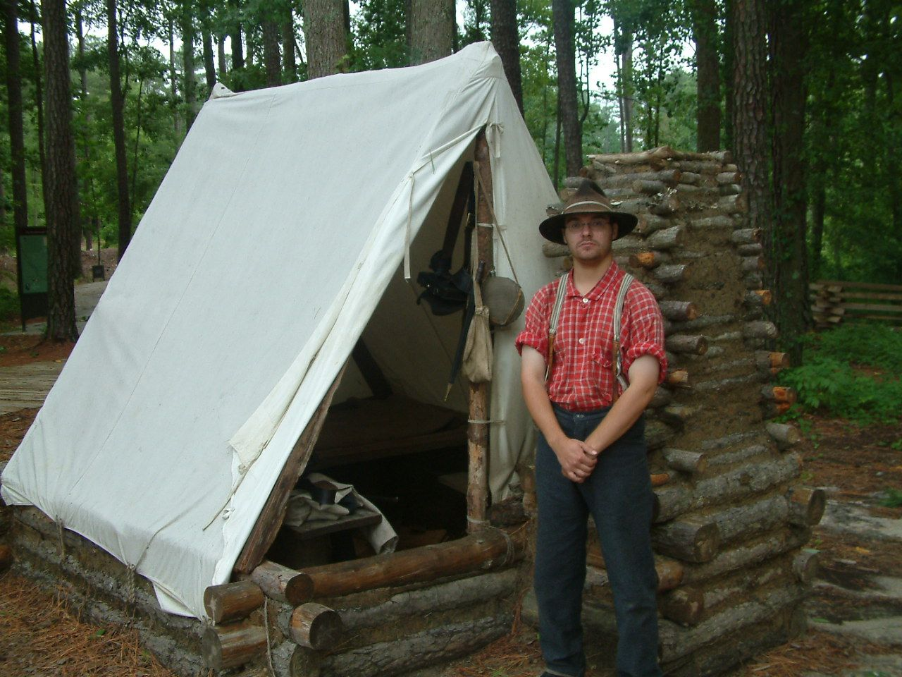 Survival shelter & Winter Camp log and mud walls to keep out cold small fire place ...