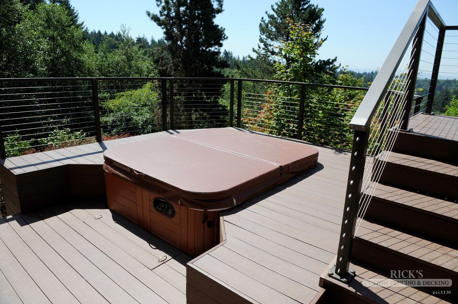 beautiful decking built around a tub adds a resort feel in