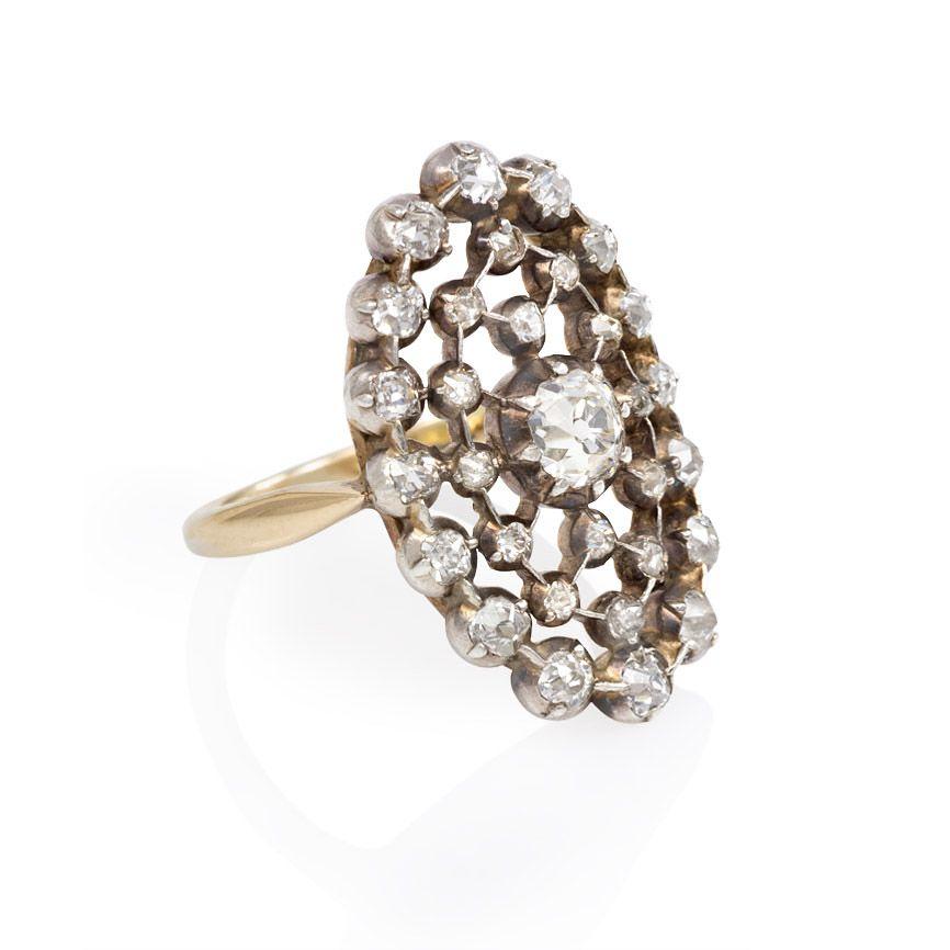 An antique old cut diamond ring of oval latticework design in