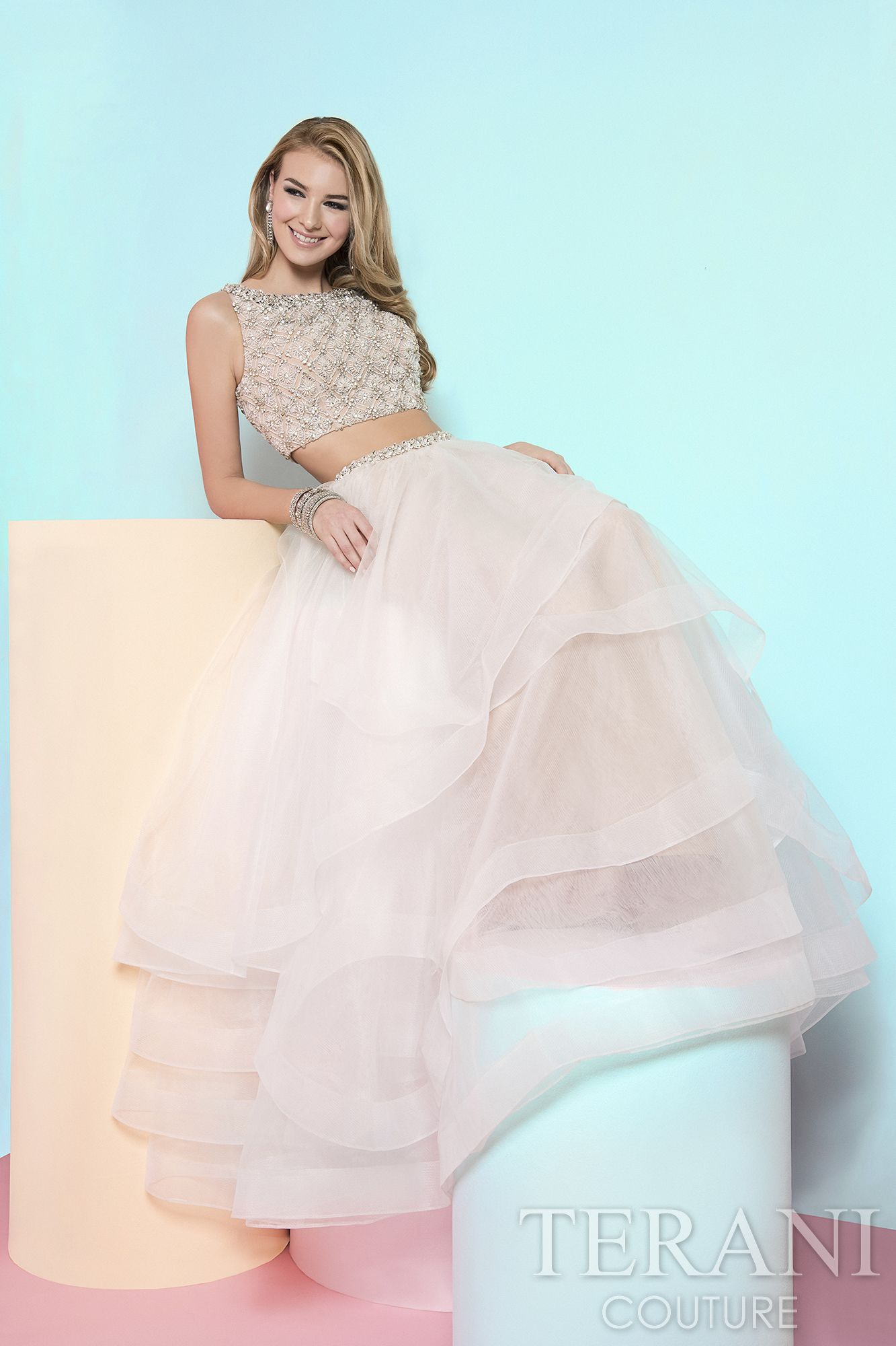 Two piece prom gown with beaded crop top. This prom dress is ...