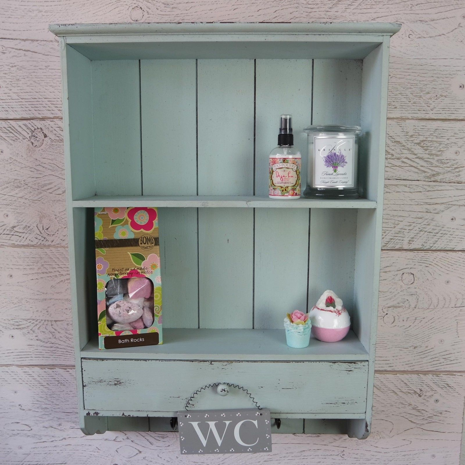 Blue wooden wall unit with 2 shelves, single drawers and hooks ...