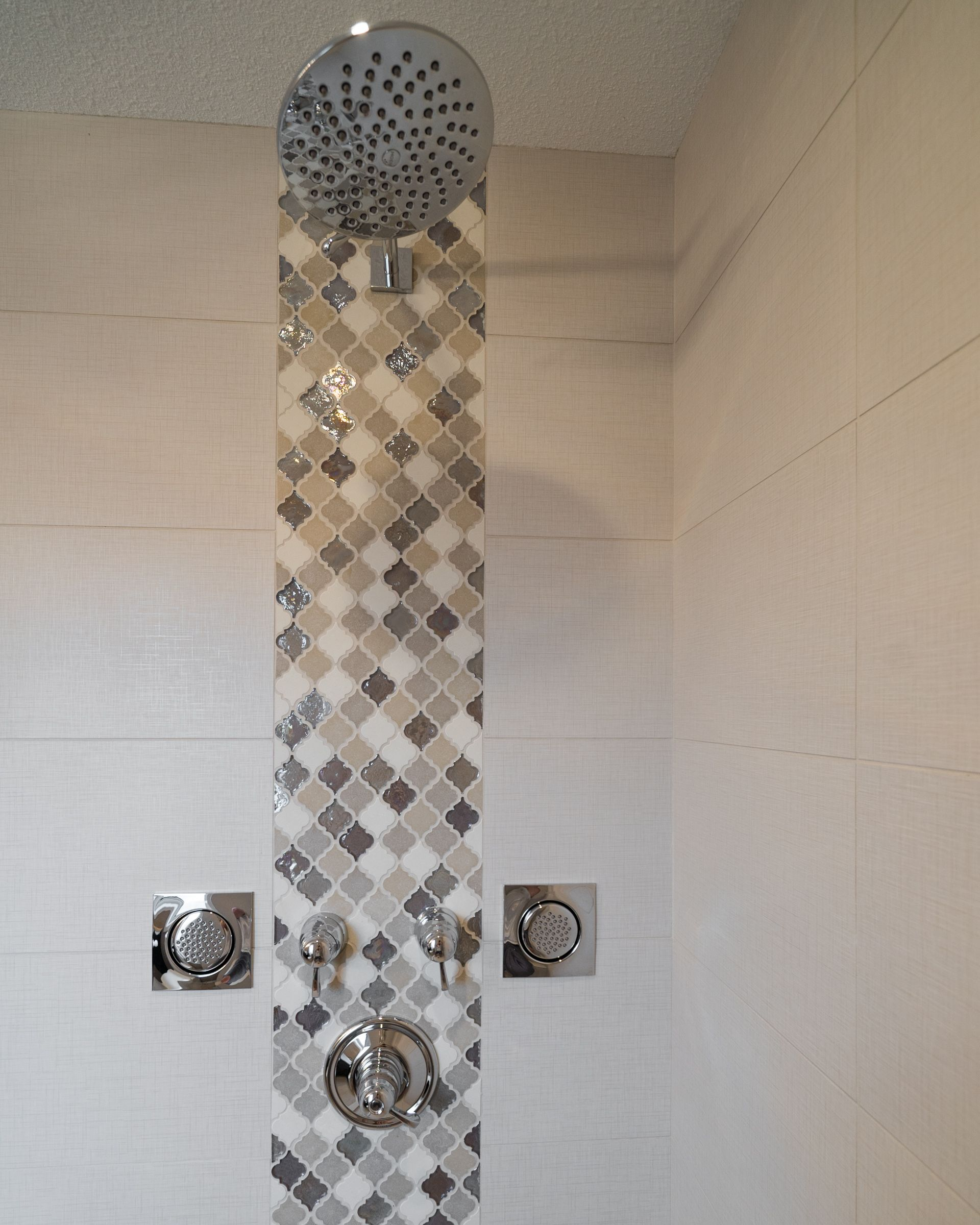 Custom tile stainless steel shower within the en-suite bathroom!