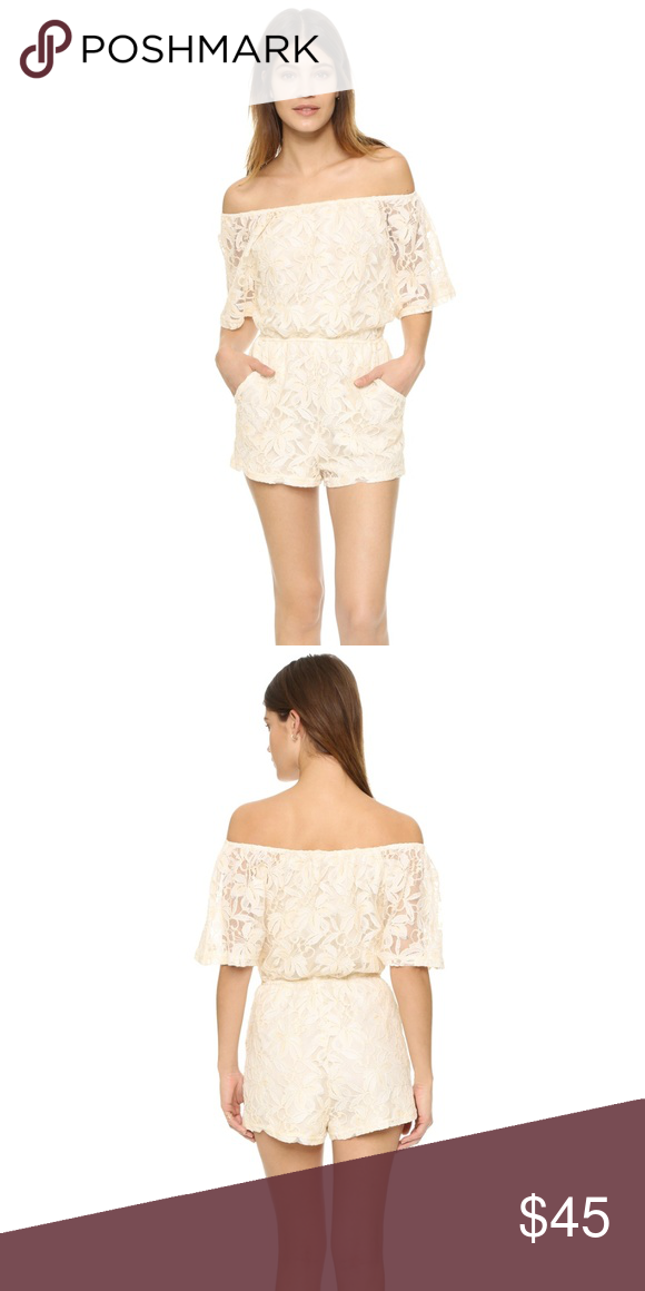 7f9499d7ebd BB Dakota Nikola Off Shoulder Romper C0205 Creme-colored floral embroidery  adds charm to this