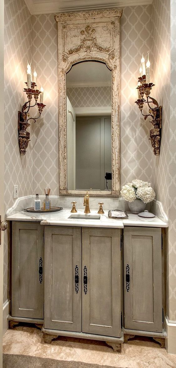 Sconces are for bathrooms too! Look how adding sconces creates such