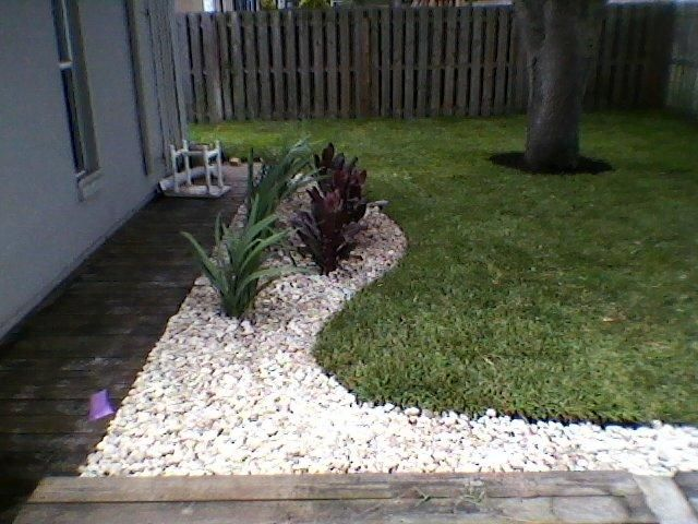 Curved White River Rock Beds To Add Character To The Backyard Landscape