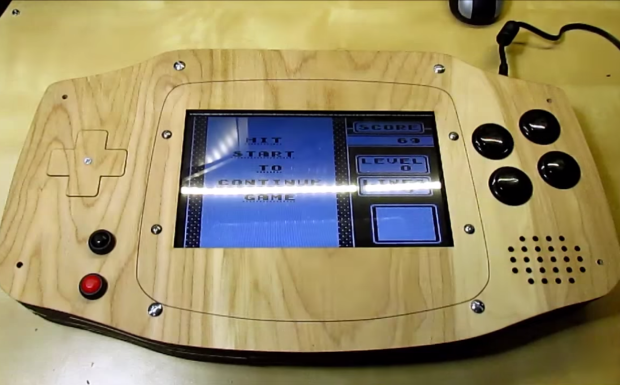 gaming on a giant playable wooden game boy advance piday