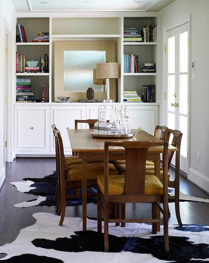 Two Cowhides Under Dining Table Perfect Even For The Modern Or Eclectic Home Rug Under Dining Table Dining Table Design Layered Rugs