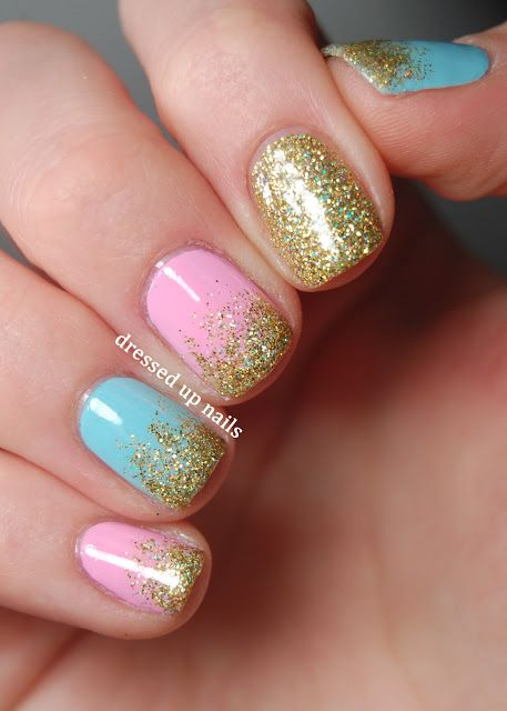 Gold glitter on pink and blue nail polish