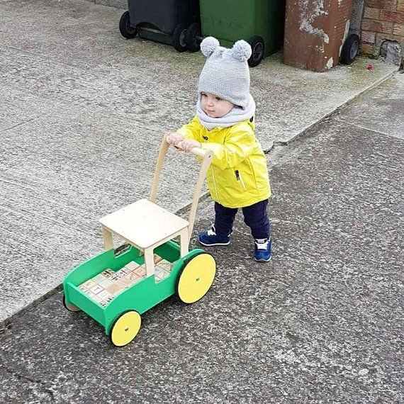 Little boys love walking with push wagons as well as girls