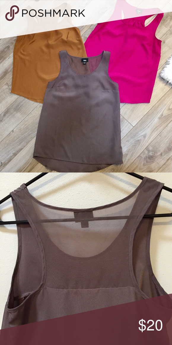 Mossimo Racerback Tank Lot These silky Mossimo tanks can be worn under a blazer at the office or with jeans and heels for a night out.  All three have a racerback but the gray/brown tank features a sheer fabric detail in the upper back and the magenta and gold tops do not. EUC. Mossimo Supply Co Tops Tank Tops