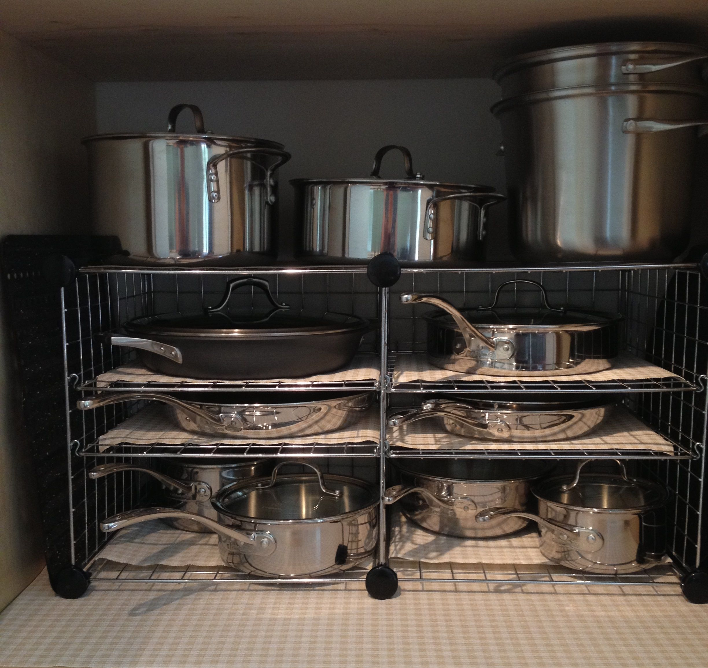 """I used four 7 8"""" S hooks to secure the shelf in the wire storage"""