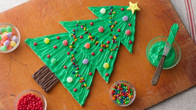 A sweet and easy memory-making activity to share with loved ones during the holidays.  Use our cookie template to make cutting out the tree a snap.
