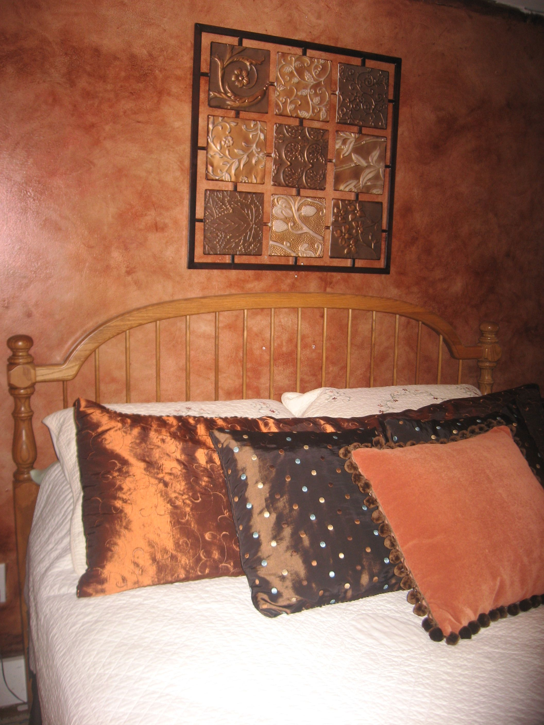 Sponge Painted Accent Wall Topped With a Coat of Stain Gives It A
