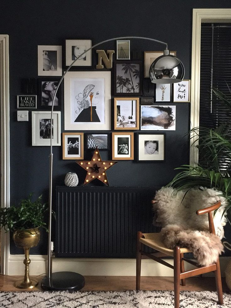 Black Walls with historic details as the backdrop of their art-filled home