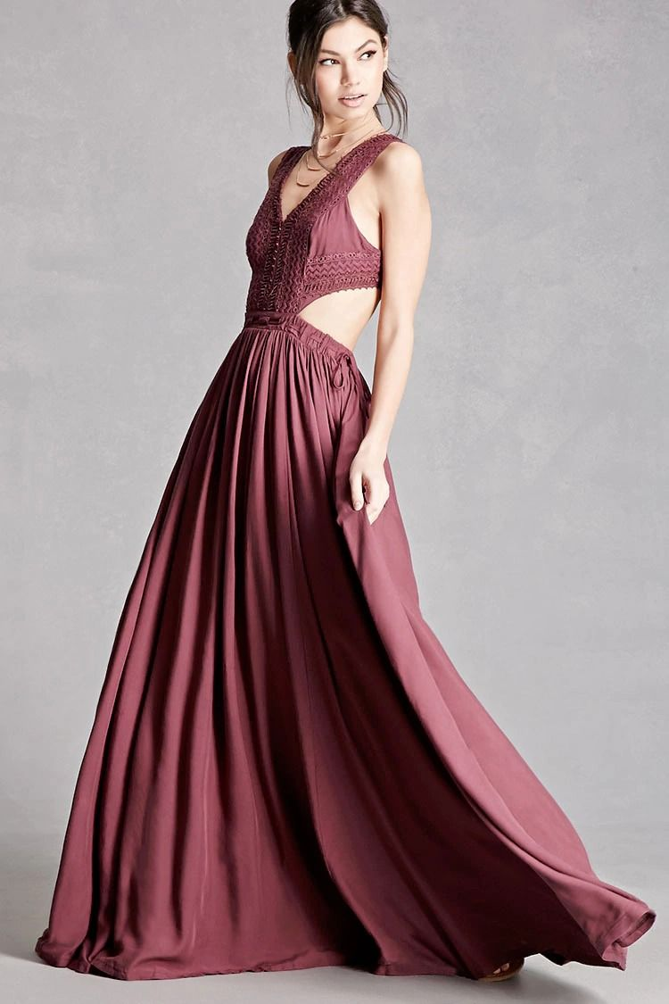 A woven maxi dress featuring a crochet bodice vneckline and back