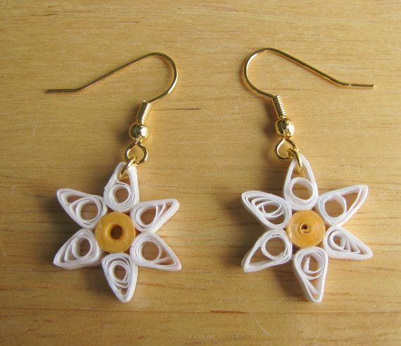 Paper quilled earrings, greeting cards, and sun catchers are available at NatureMaid Treasures.