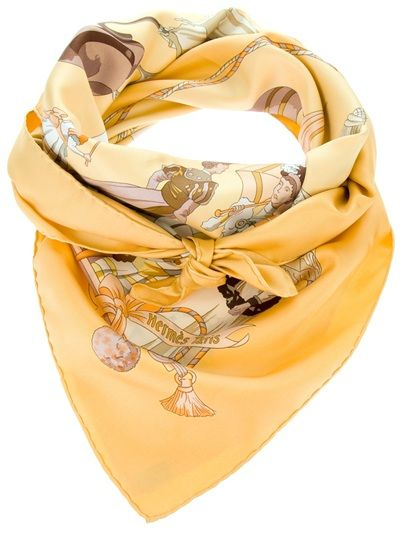 Yellow silk scarf from Hermès featuring a square shape and a multi-coloured umbrella print. Please note that vintage items are not new and therefore might have minor imperfections.