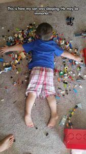kid laying on legos