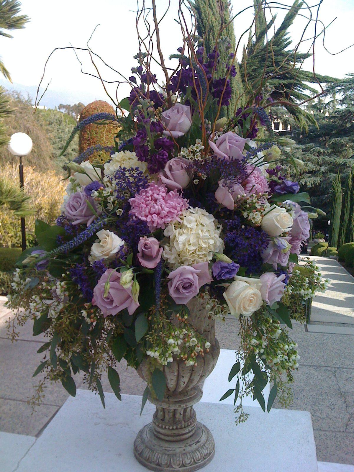 Royal purple urn wedding and flower arrangements