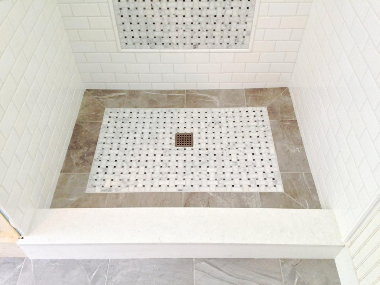 Custom shower floor installed by valley floors basketweave marble custom shower floor installed by valley floors basketweave marble is surrounded by a porcelain tile dailygadgetfo Choice Image