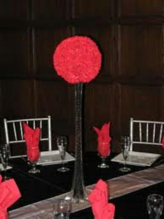 Red Pomander Ball With Eiffel Tower Vase Filled With Black Beads