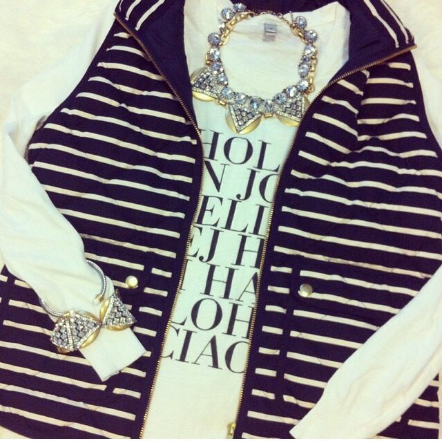 Love the vest, sweater and statement jewelry.