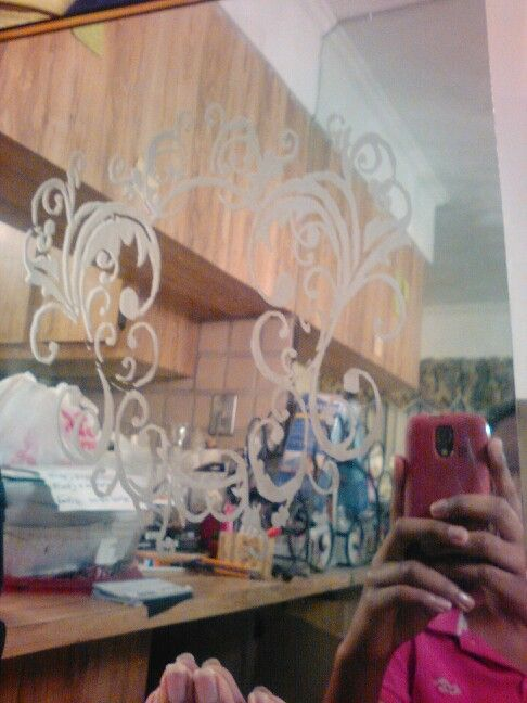 Artwork of a mirror with designs on it