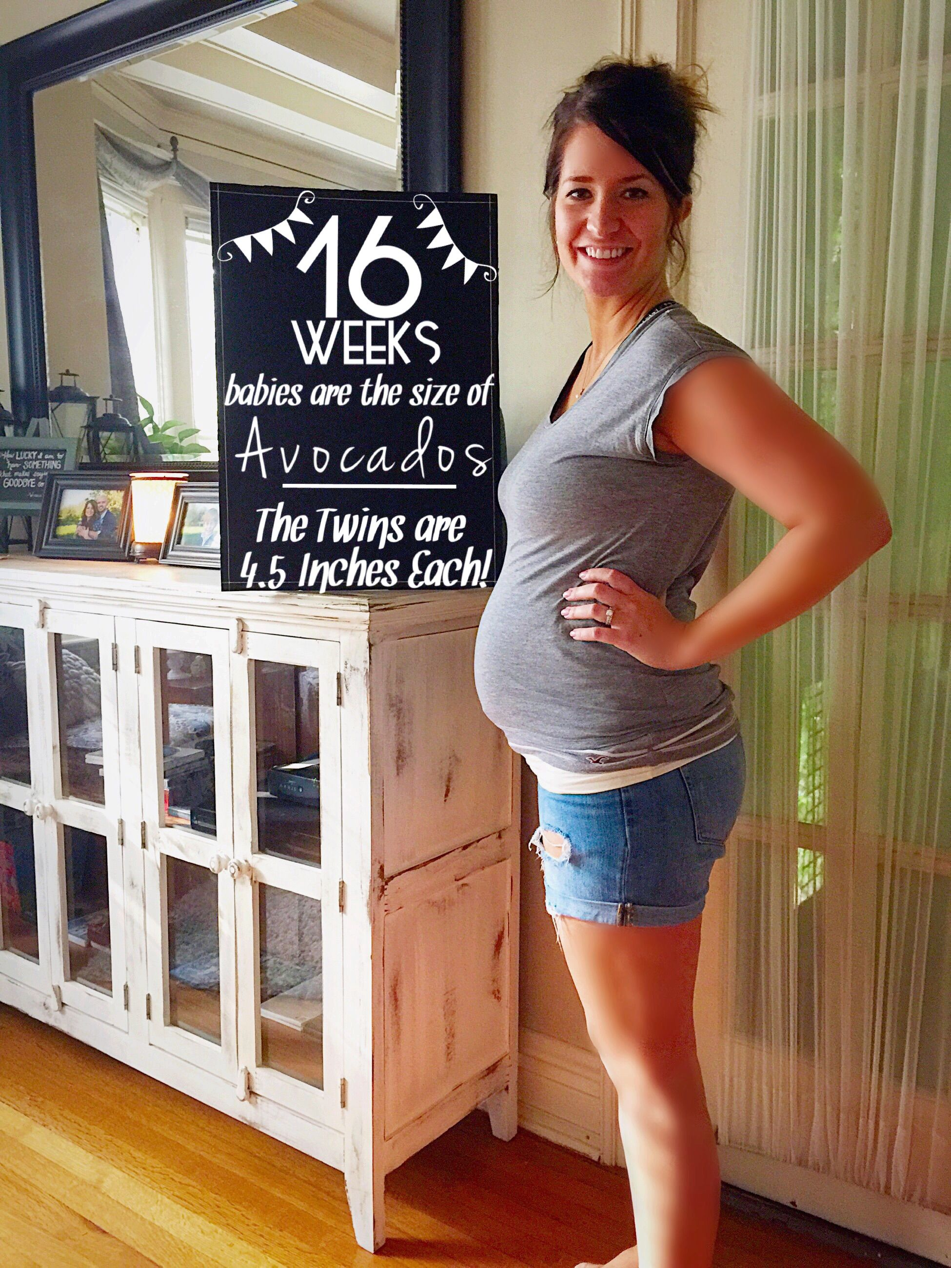 16 Weeks Pregnant with Twins. Sporting normal clothes with the help of my  Pure Belly Wrap.