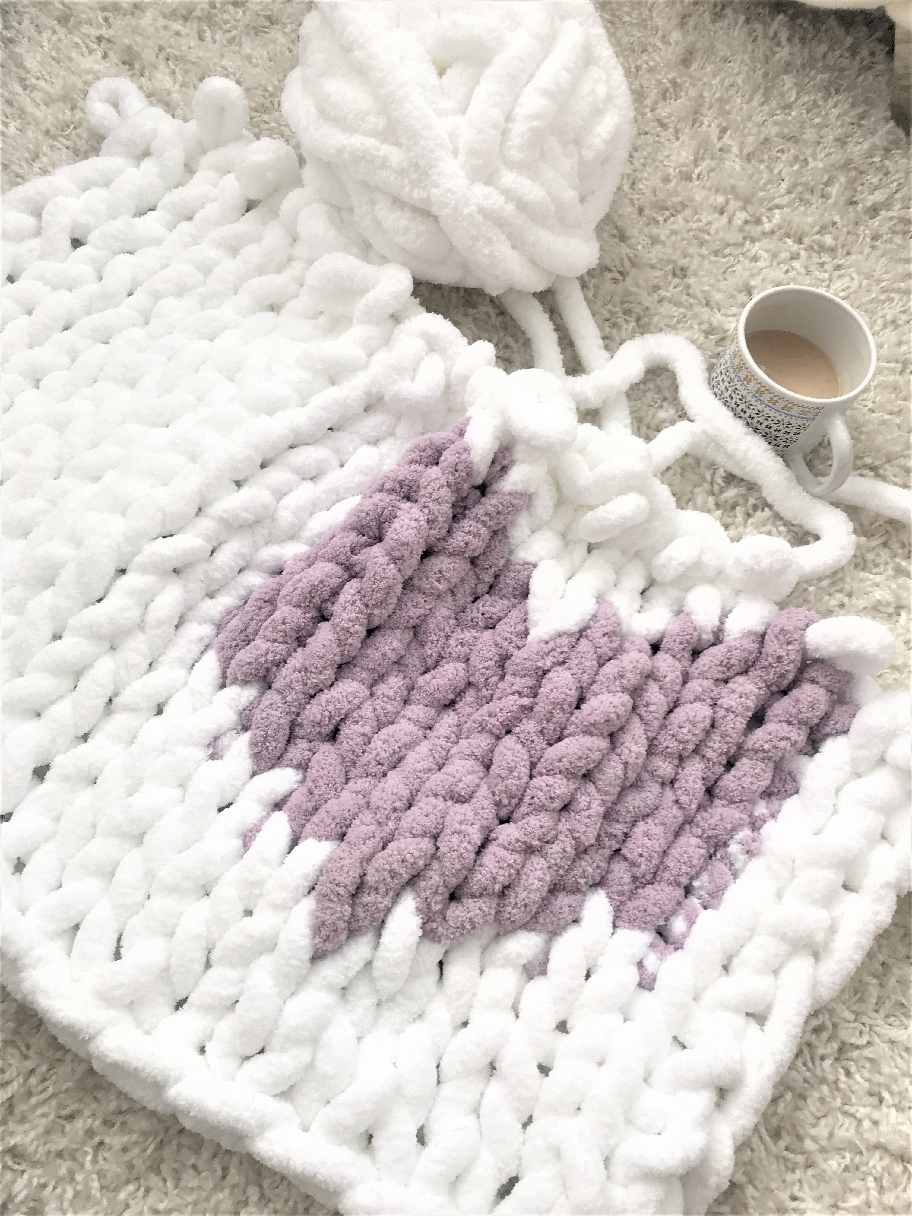 Hand knit a chunky blanket with a heart watch our easy