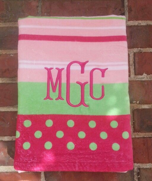 Fishtail font monogram done on a beach towel embroidery
