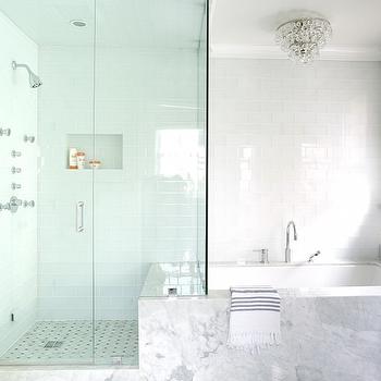 White Glass Tub Backsplash Tiles Extend Into Shower