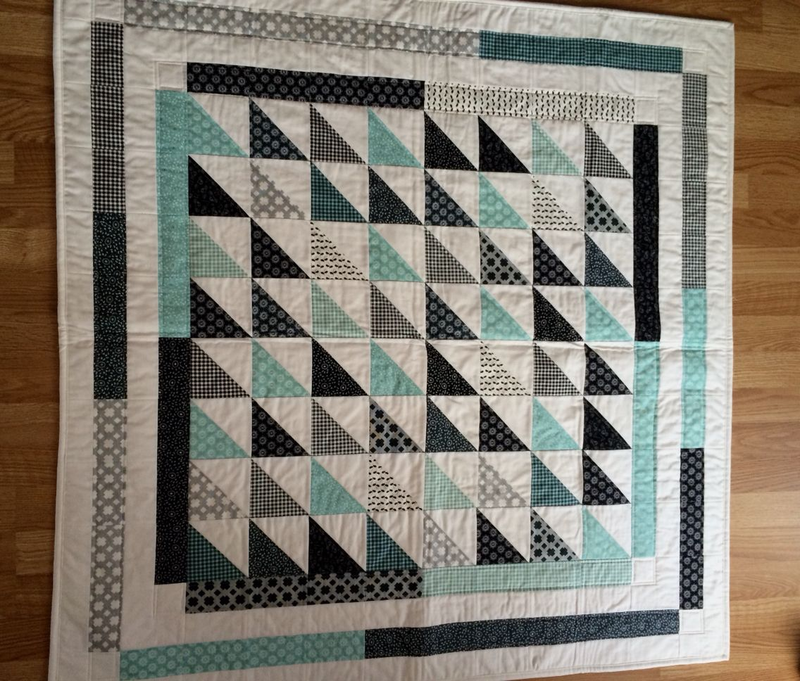 Half Square Triangle Quilt With Improv Floating Borders