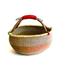 Artisans in the Bolgatanga region of Ghana weave these beautiful and durable baskets from thick, tough elephant grass. A popular choice among green shoppers, busy mothers and picnic planners worldwide, Bolga market baskets stand up to use and abuse and remain functional and beautiful for years.