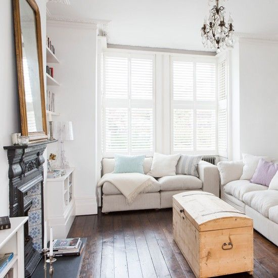 White Living Room With Shutters
