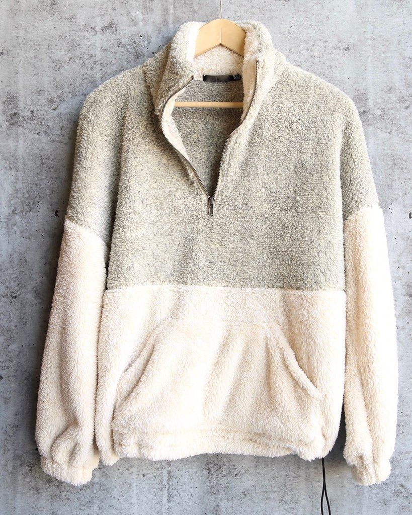 this frosted tip pullover is your answer to year round coziness  plush two toned faux fur