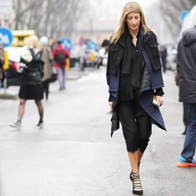 A spot of rain doesn't stop our Vice President of Global Buying #SarahRutson when it comes to fashion week! #PFW Photograph by Anthea Simms Photography