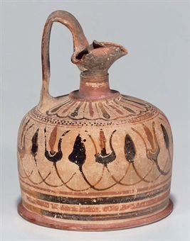 A GREEK POTTERY SQUAT LEKYTHOS  CIRCA MID 6TH CENTURY B.C.