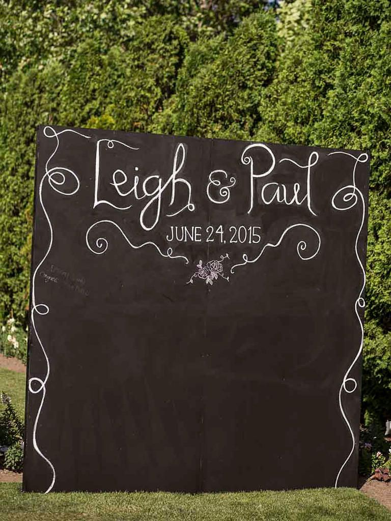 Doodle a DIY chalkboard background for a wedding photo booth idea that is ultra-modern and creative.