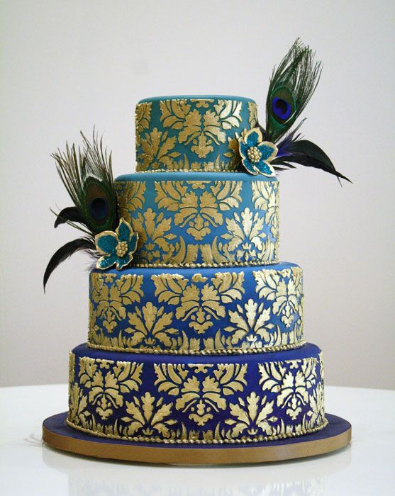 Peacock feather wedding cake -- easier than it looks. tinted fondant + stencil + gold lustre dust