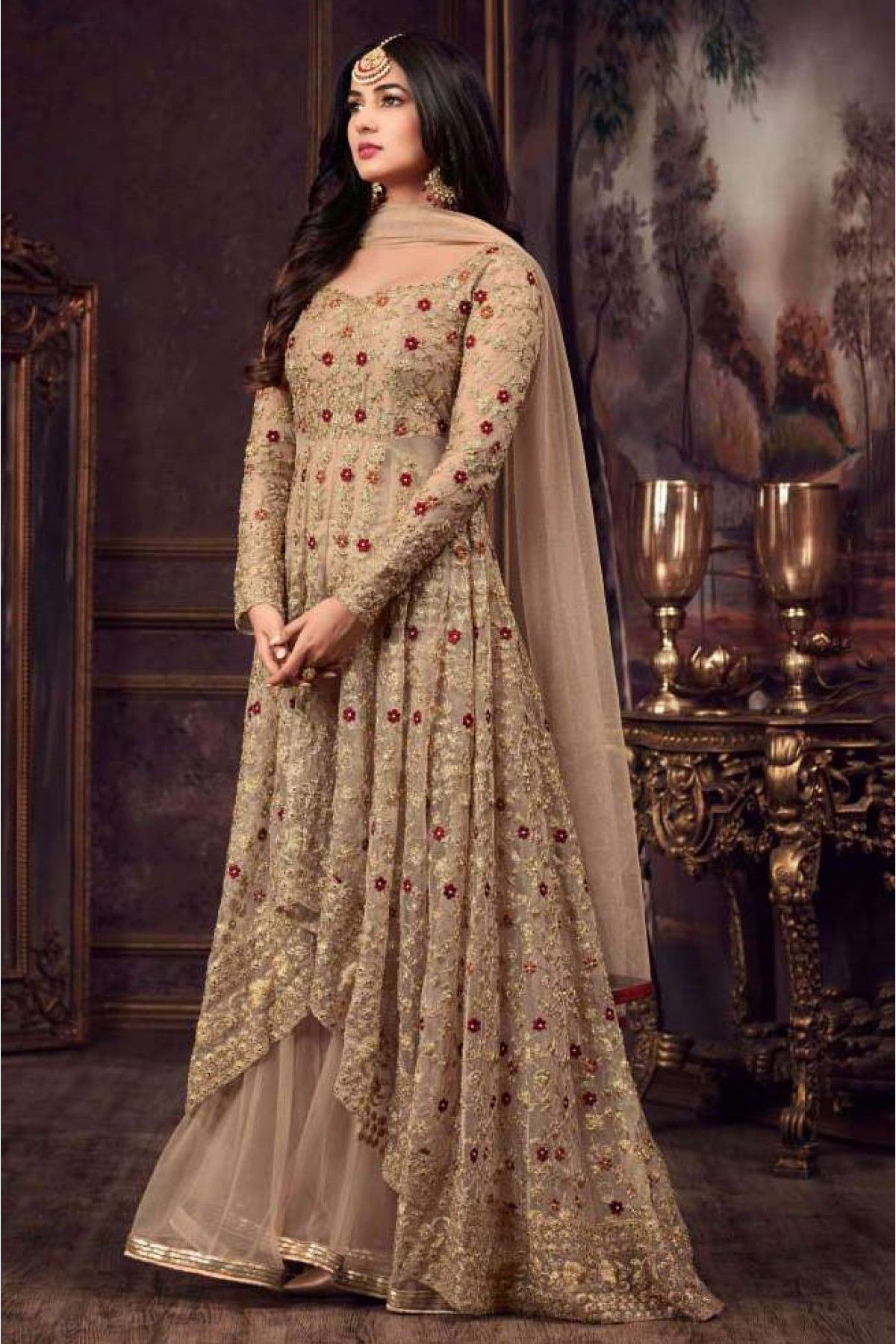 4d10f41c27 This Super Stylish Net Fabric Is Exclusively Crafted With Embroidery. The  Chiku Colour Straight Suit Comes With Matching Bottom And Dupatta.