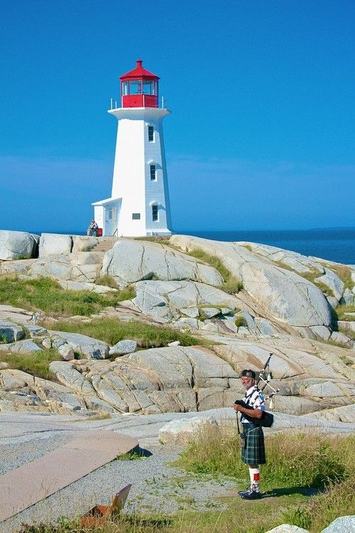 Playing the pipes at Peggy's Cove by markl23