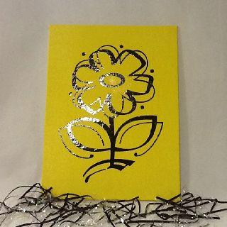 Vinyl flower on yellow canvas