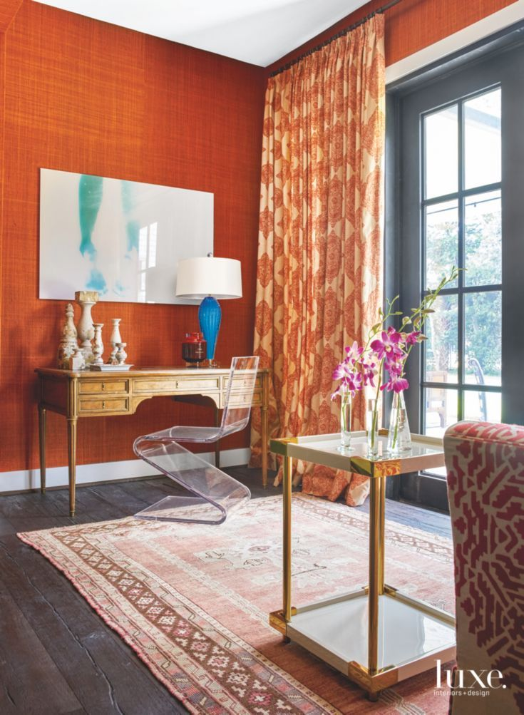 Orange Wallpaper Reading Room with Modern Clear Chair