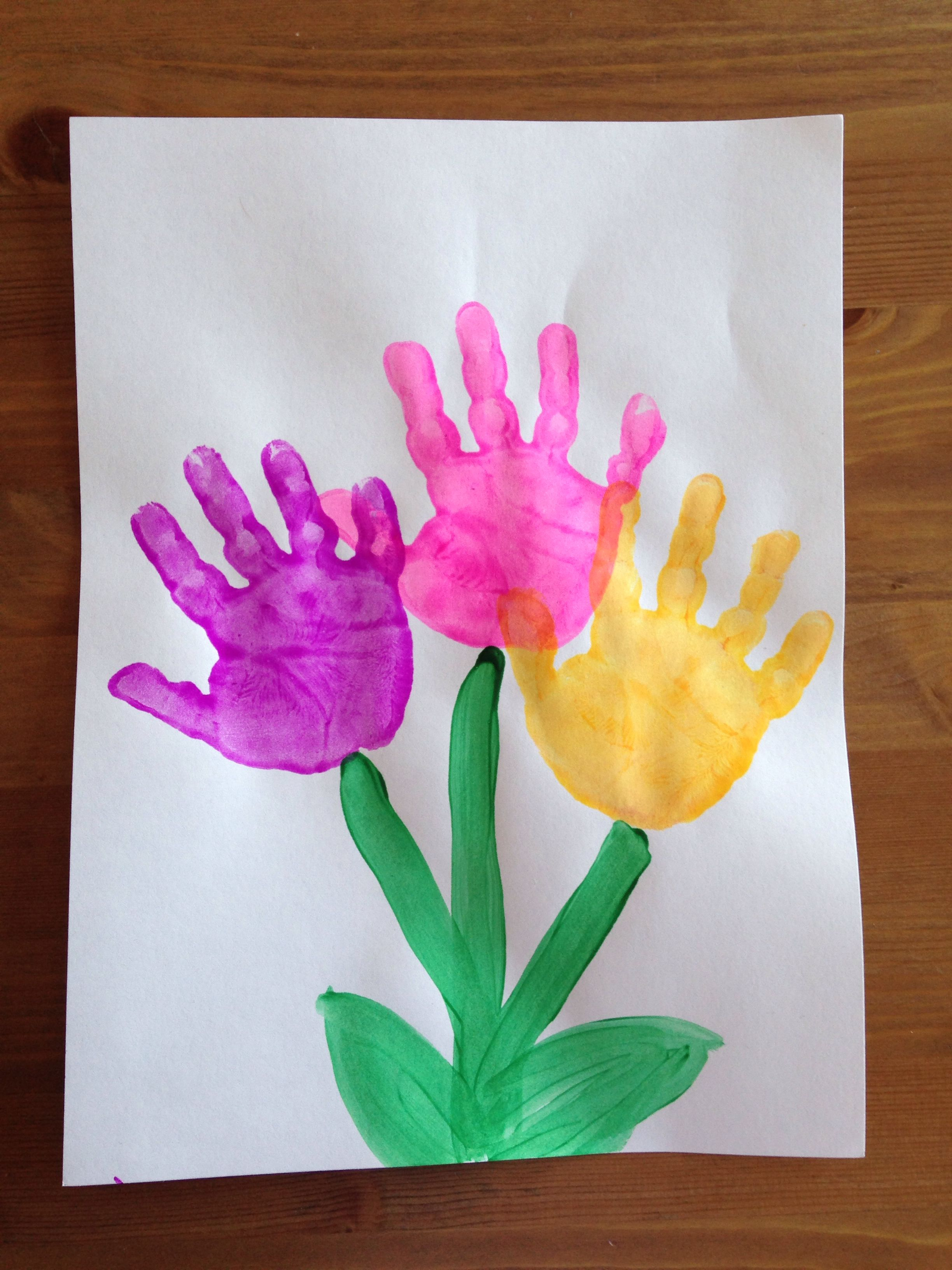 Handprint flower craft spring craft preschool craft for Preschool spring craft ideas
