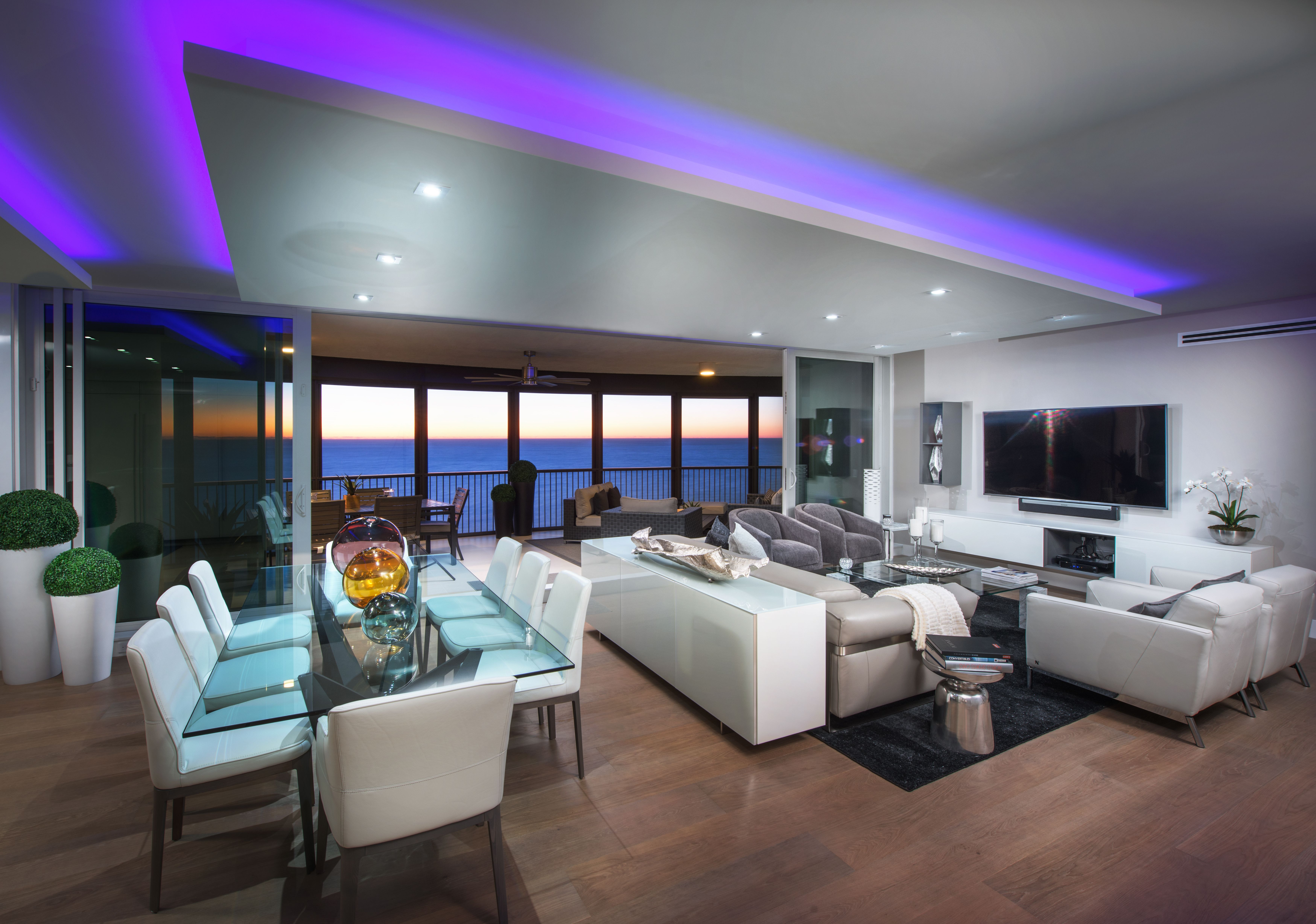 Stunning wood flooring, multicolor cove lighting, and a