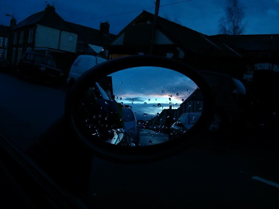 Crap day, got home and the rain stopped. I look up and get a pleasant visual surprise via my wing mirror.