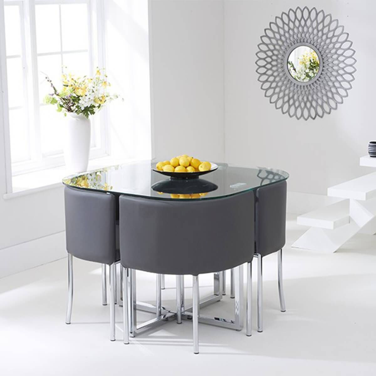 The Abingdon Glass 4 Seater Stowaway Dining Set Is A Distinctly Stylish Set And Is Extr Compact Dining Table Space Saving Dining Table Black Glass Dining Table