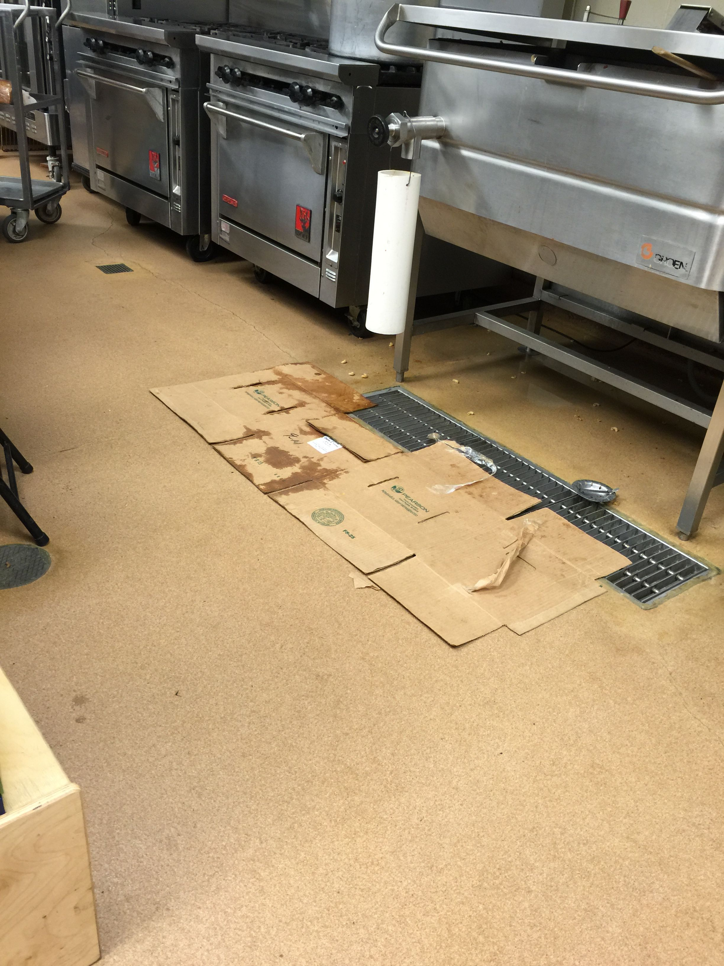 Cook Uses Cardboard As Floor Mat - October 2015