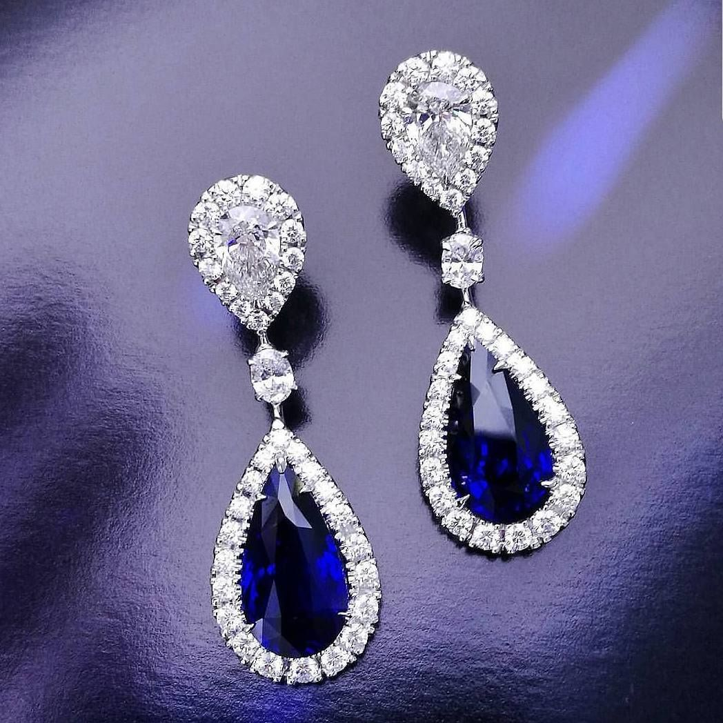 Deep Blue Sapphire And White Diamond Halo Earrings In 14 Karat White Gold Each Sapph Sapphire And Diamond Earrings Diamond Earrings Studs Halo Diamond Earrings