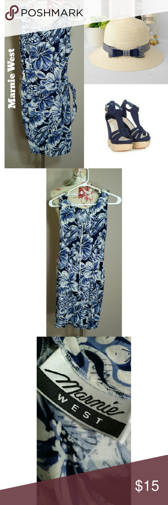 Vintage Tropical Dress A super soft blue and white floral print wrap style dress with short sleeves. Marnie West brand cotton blend. Pre-loved but in great condition with no visible flaws.  Flat Measurements: Bust 14 inches Waist 13 inches Length 33 inches Vintage Dresses Midi